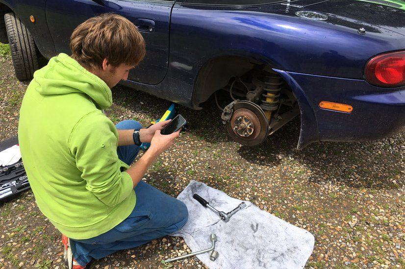 Man changing wheel bearing