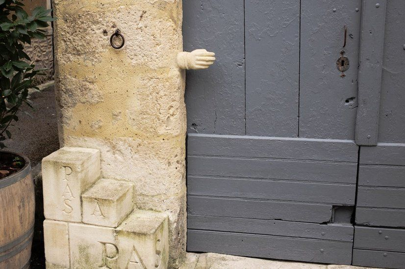 Stone hand sculpture in in Issigeac, France