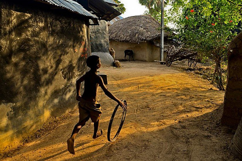 Boy with metal hoop