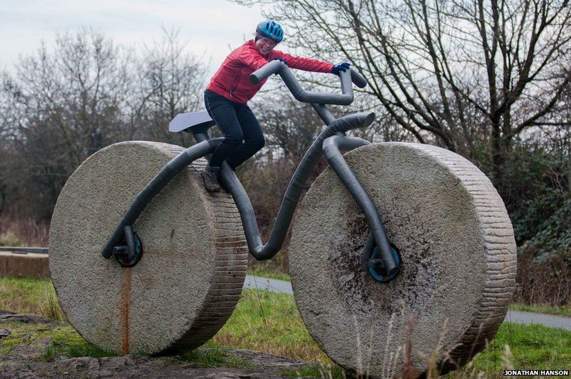 Cyclist on stone sculpture