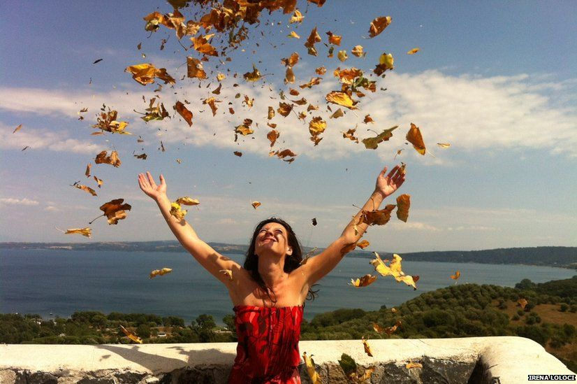 Woman throwing leaves in the air