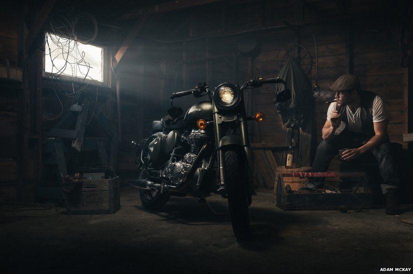 Man and Royal Enfield motorcyle