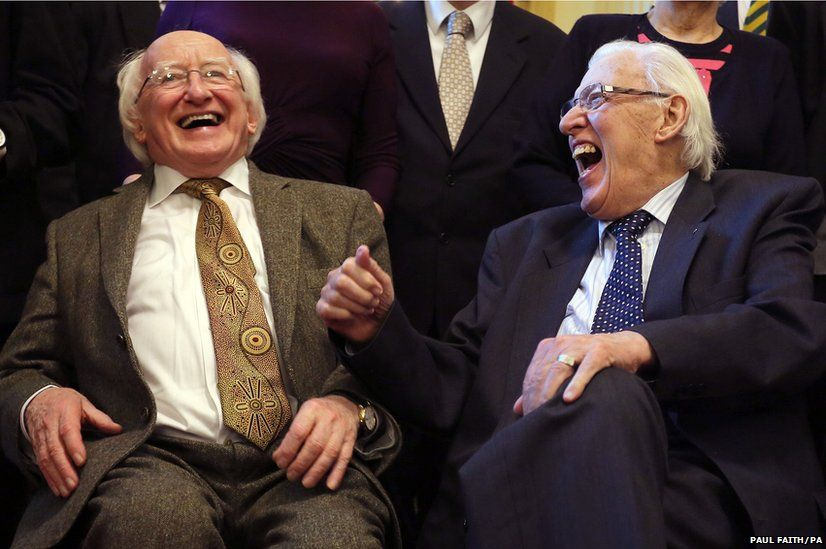Irish President Michael D Higgins (left) shares a joke with Ian Paisley, former First Minister of Northern Ireland, during a reception at Belfast City Hall to mark St Columbanus Day