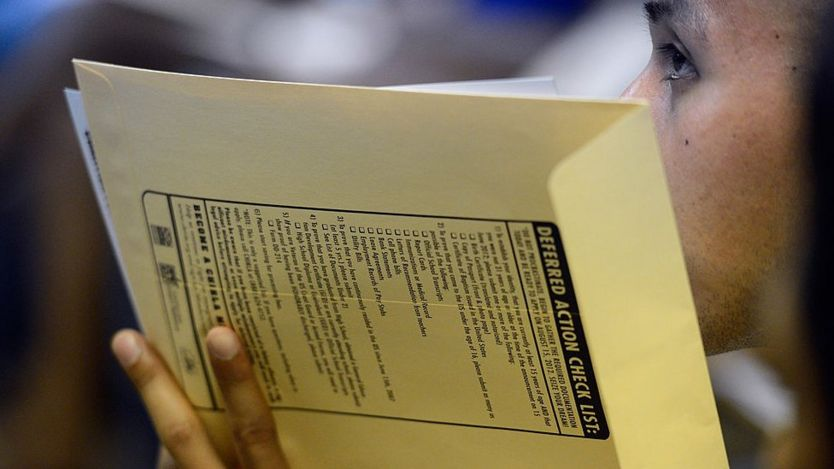 A young person waits to submit their application for the Daca programme in 2012.