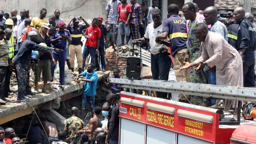 Rescue workers search for survivors at the site of a collapsed building containing a school in Nigeria's commercial capital of Lagos, Nigeria March 13, 2019.