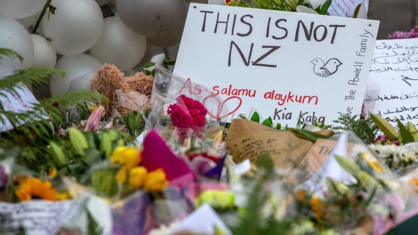 Messages and flowers are left near Al Noor mosque on March 17, 2019 in Christchurch, New Zealand