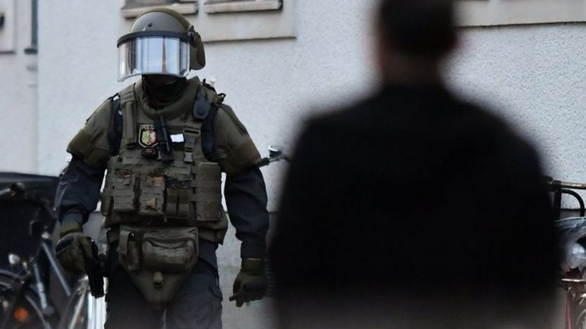 Highly armed police officer wearing specialist protective gear
