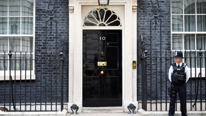 A policeman stands on guard outside No 10 Downing Street
