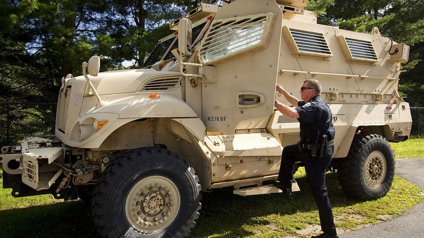 A police officer in Maine steps into a mine resistant ambush protected vehicle