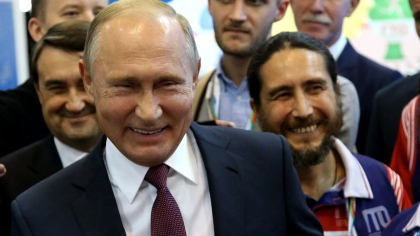 Russian President Vladimir Putin smiles during his meeting with athletes at the Russia in October 2018