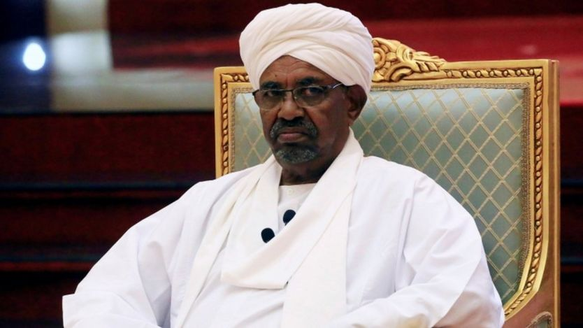 President Omar al-Bashir sitting on a green chair dressed in white at the National Dialogue Committee at his palace in Khartoum on April 5