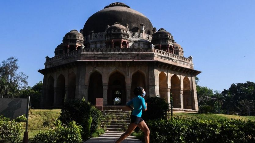 A woman jogs at Lodhi Garden after the local government eased restrictions imposed as a preventive measure against the spread of the COVID-19 coronavirus in New Delhi on May 21, 2020.