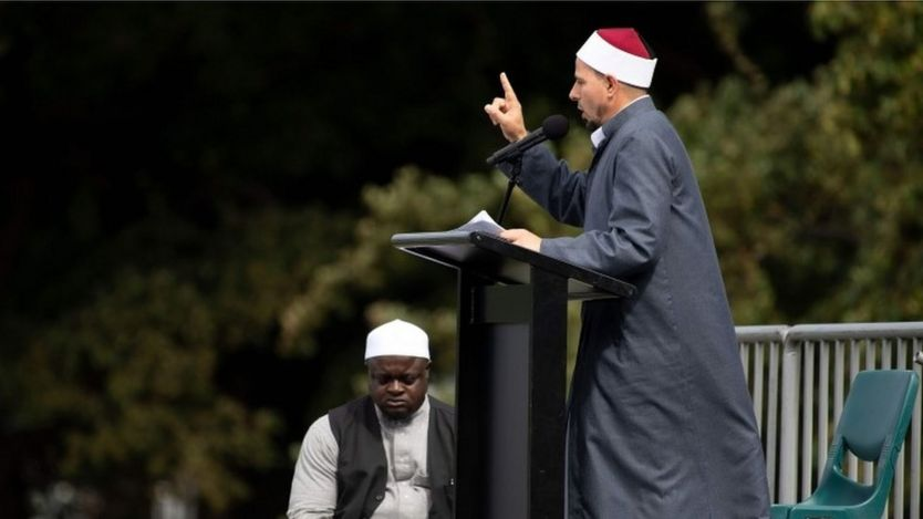 Gamal Fouda, the imam (lead cleric) of tragedy-stricken Al Noor mosque, delivers a sermon ahead of a two-minute observation of silence for victims of the twin mosque massacre, during congregational Friday prayers and memorial gathering at Hagley Park in Christchurch on March 22, 2109.