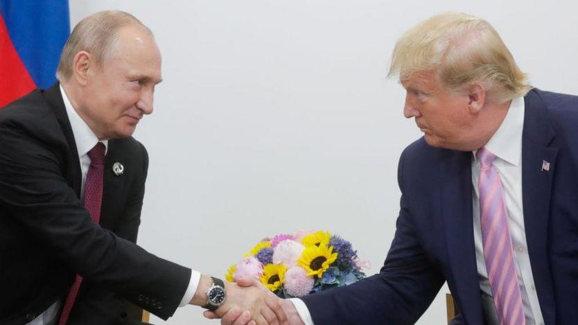 Vladimir Putin and Donald Trump shaking hands at the G20 summit in Osaka in 2019