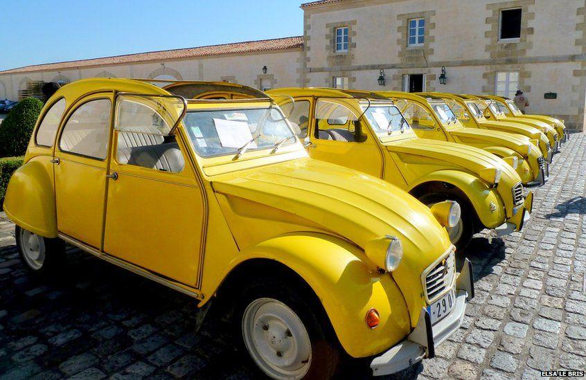 Yellow 2CV cars