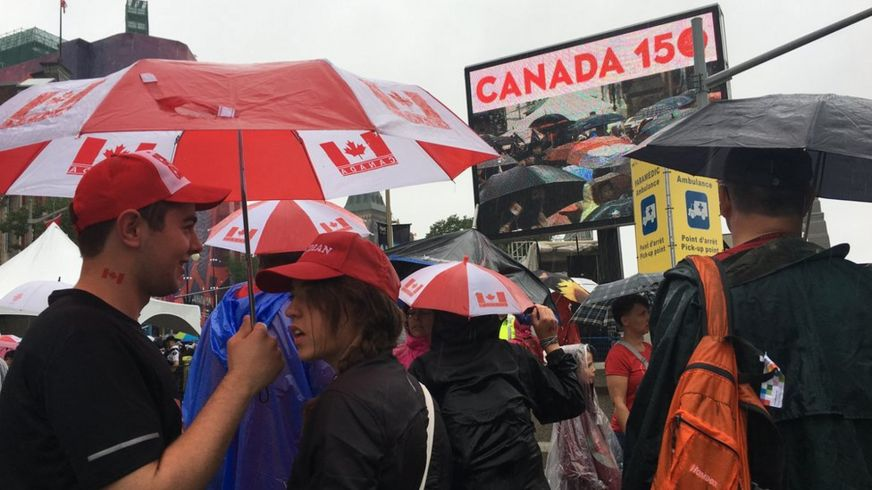 Canadians hold umbrellas on Canada Day in Ottawa