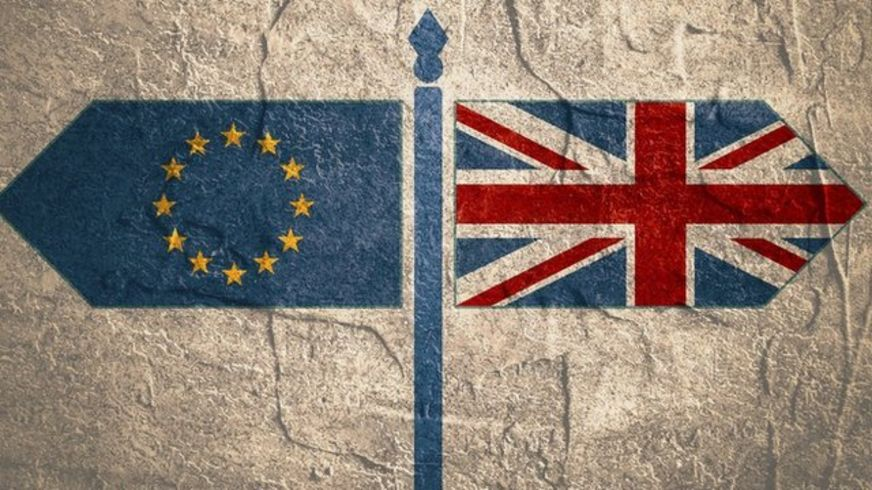 EU and UK flags pointing in opposite directions