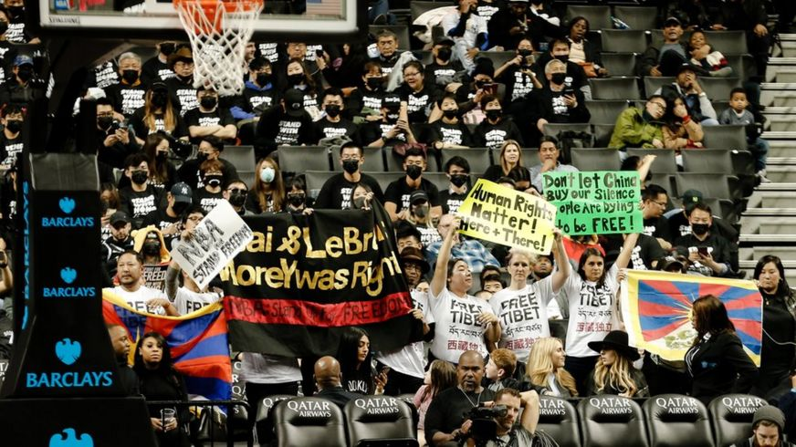 Protesters gather at a basketball game in New York