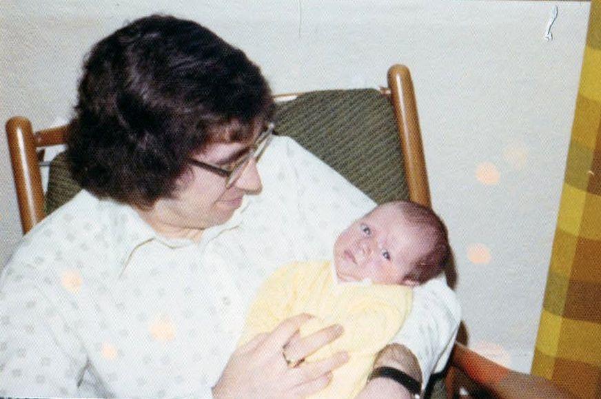 Don Cunningham holding his newborn son, Iain