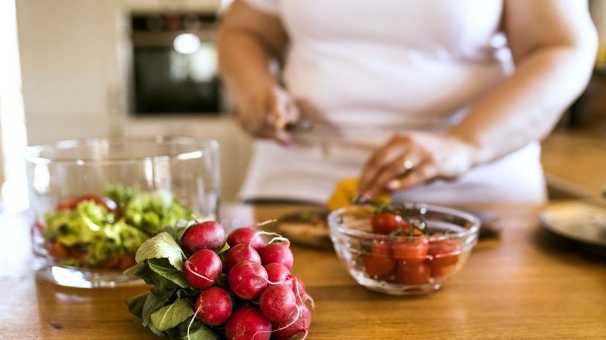 Overweight woman preparing healthy food
