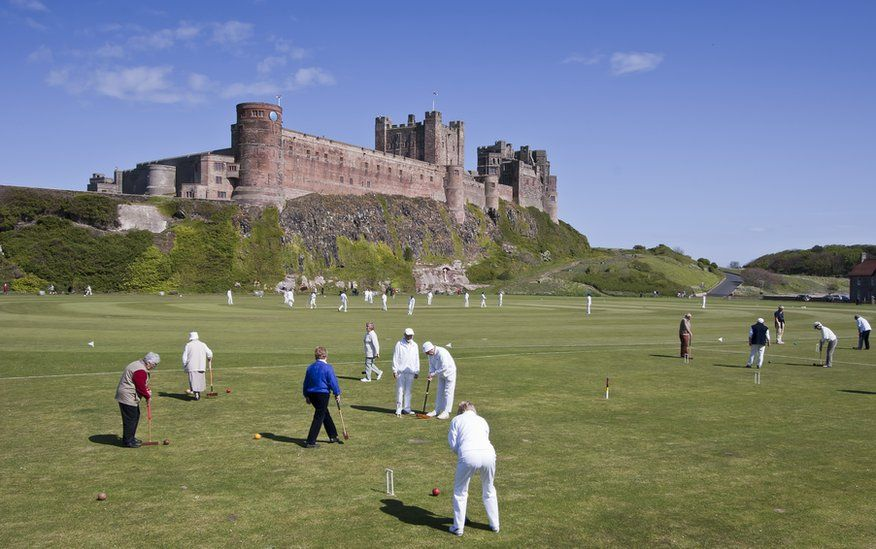 People playing croquet and cricket