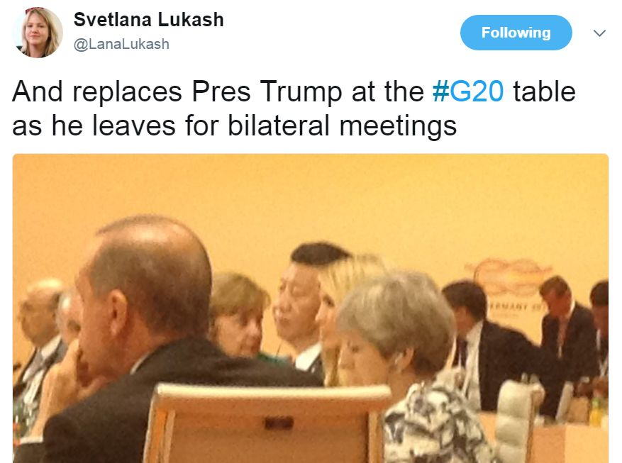 """Tweet from @LanaLukash with a photo of the table: """"And replaces Pres Trump at the #G20 table as he leaves for bilateral meetings"""""""