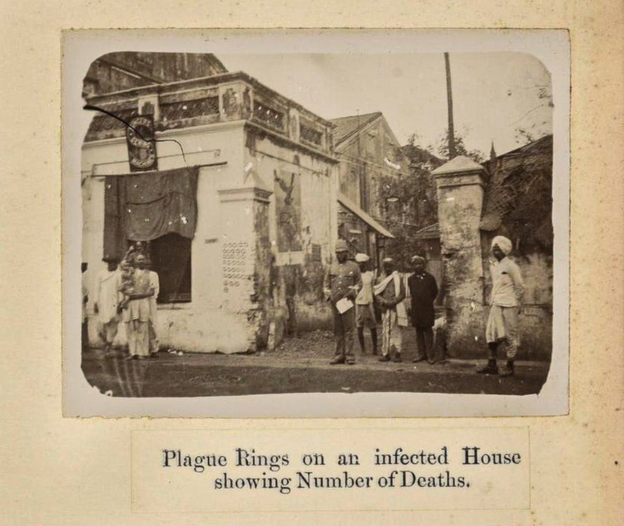 Rings chalked on a Bombay home showing the number of plague cases within