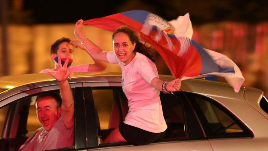 Opposition supporters celebrate election results in Podgorica, Montenegro, 31 August