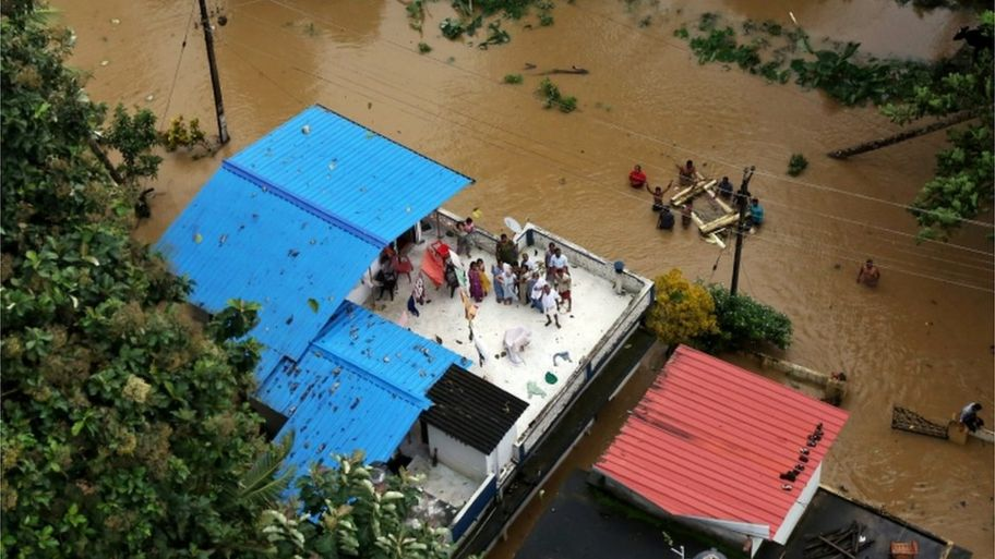 people on a Kerala rooftop waiting to be rescued