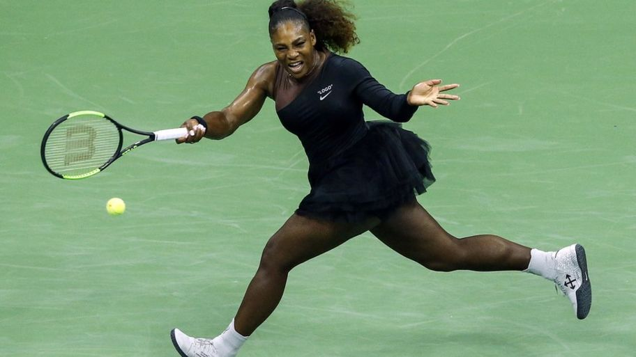 2518f4a9226 Serena Williams wearing her black tutu tennis dress whilst holding a racket
