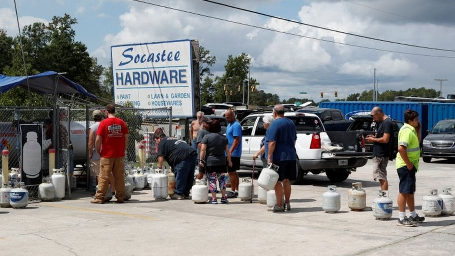 Customers line up to buy propane at Socastee Hardware store, ahead of the arrival of Hurricane Florence in Myrtle Beach, South Carolina,