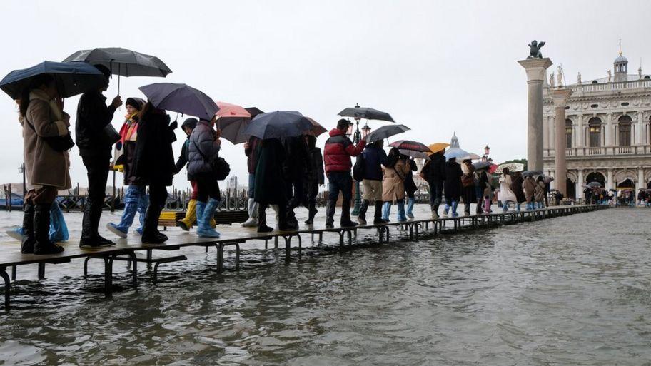 people-walking-catwalk-floods.