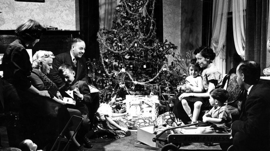 family around christmas tree in 1947