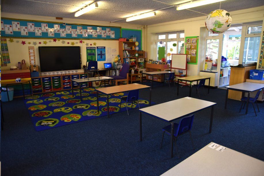 Desks are in rows facing the front