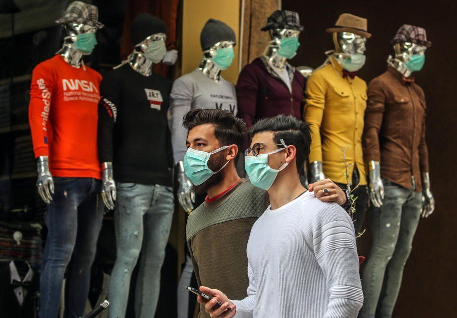 Palestinians wearing face masks