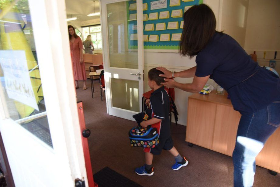 Mother sends child into classroom