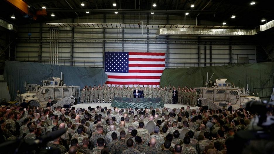 US President Donald Trump addresses US troops during an unannounced visit to Bagram air base in Afghanistan in November 2019