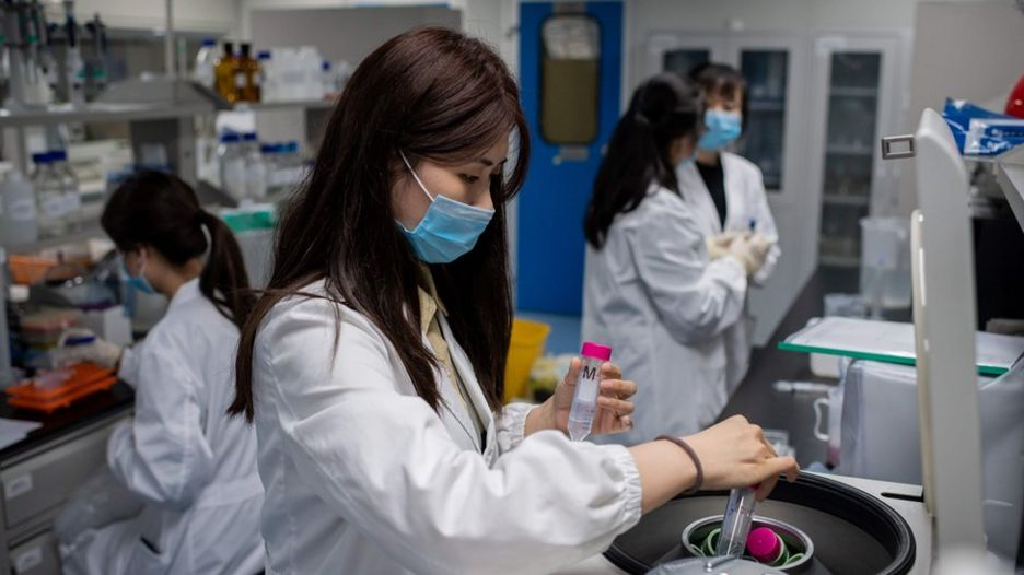 Scientists in lab in Beijing working on coronavirus vaccine
