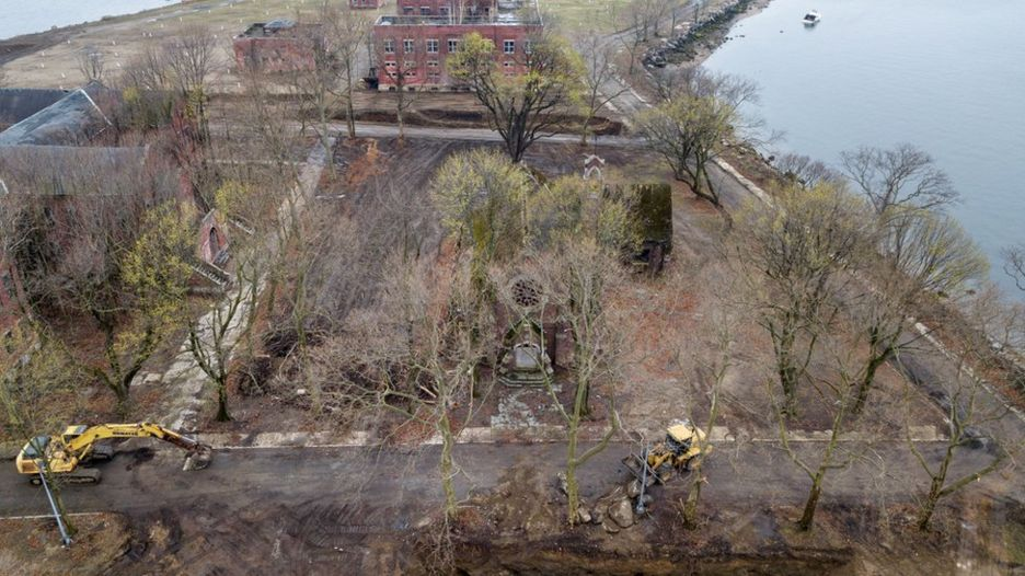 Heavy machinery digs a trench near two existing mass graves on Hart Island in the Bronx borough of New York City