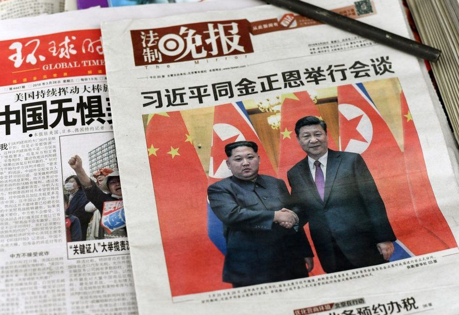The front pages of Chinese evening newspapers, showing images of China's President Xi Jinping with North Korean leader Kim Jong-un on 28 March, 2018