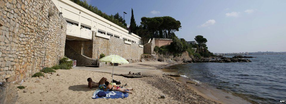 """General view of the public beach called """"La Mirandole"""", located below a villa owned by the Saudi King, on 20 July, 2015"""