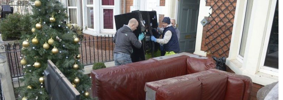Residents clean out their house in Carlisle
