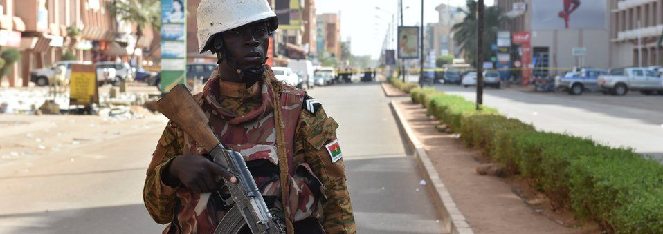 "A soldier of Burkina Faso""s army stands guard outside the Splendid Hotel and nearby Cappuccino restaurant following a jihadist attack in Ouagadougou"