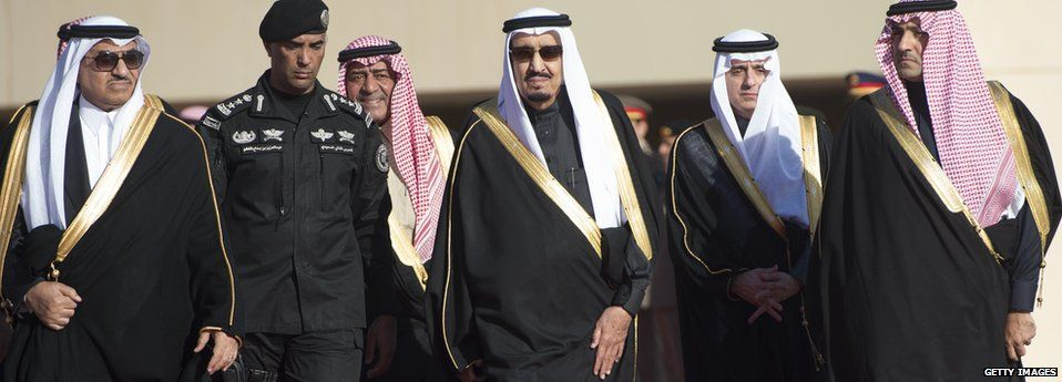 King Salman and officials in file photo dated January 2015