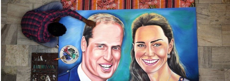 Artist Jagjot Singh Rubal puts the finishing touches to a painting of the Duke and Duchess of Cambridge at his studio in Amritsar
