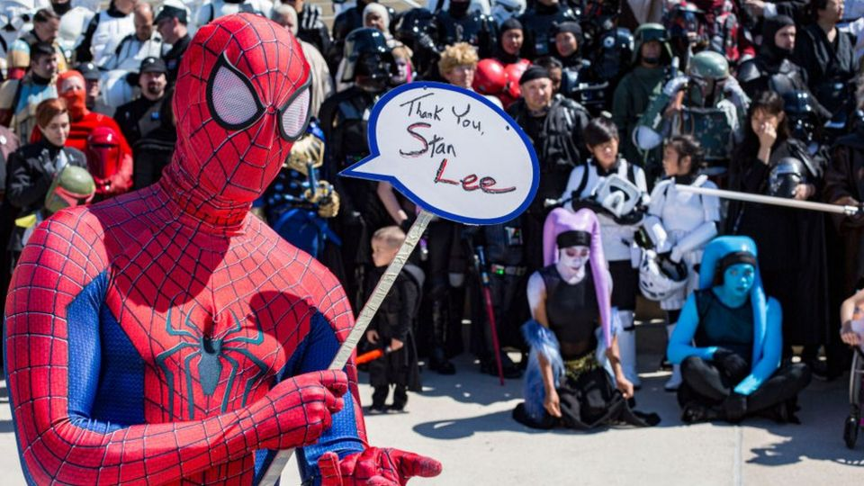 Spider-Man-costume-holding-sign-up.