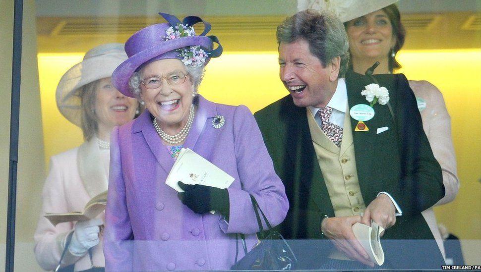 Queen Elizabeth II celebrates her horse winning the Gold Cup alongside her racing manager John Warren