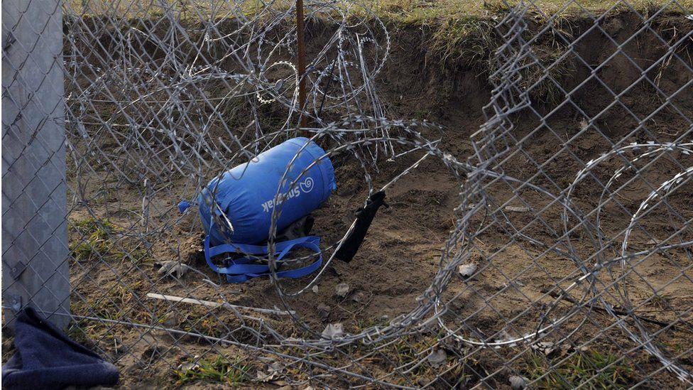 A part of the damaged border fence near the border village of Roszke, Hungary, 9 February 2016