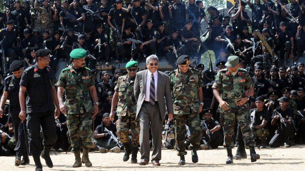 Sri Lanka's former Defence Secretary Gotabhaya Rajapaksa (C) pictured in 2010