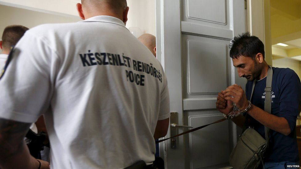 Suspects from lorry migrant deaths in Austria arrive at court in Hungary, 29 August 2015